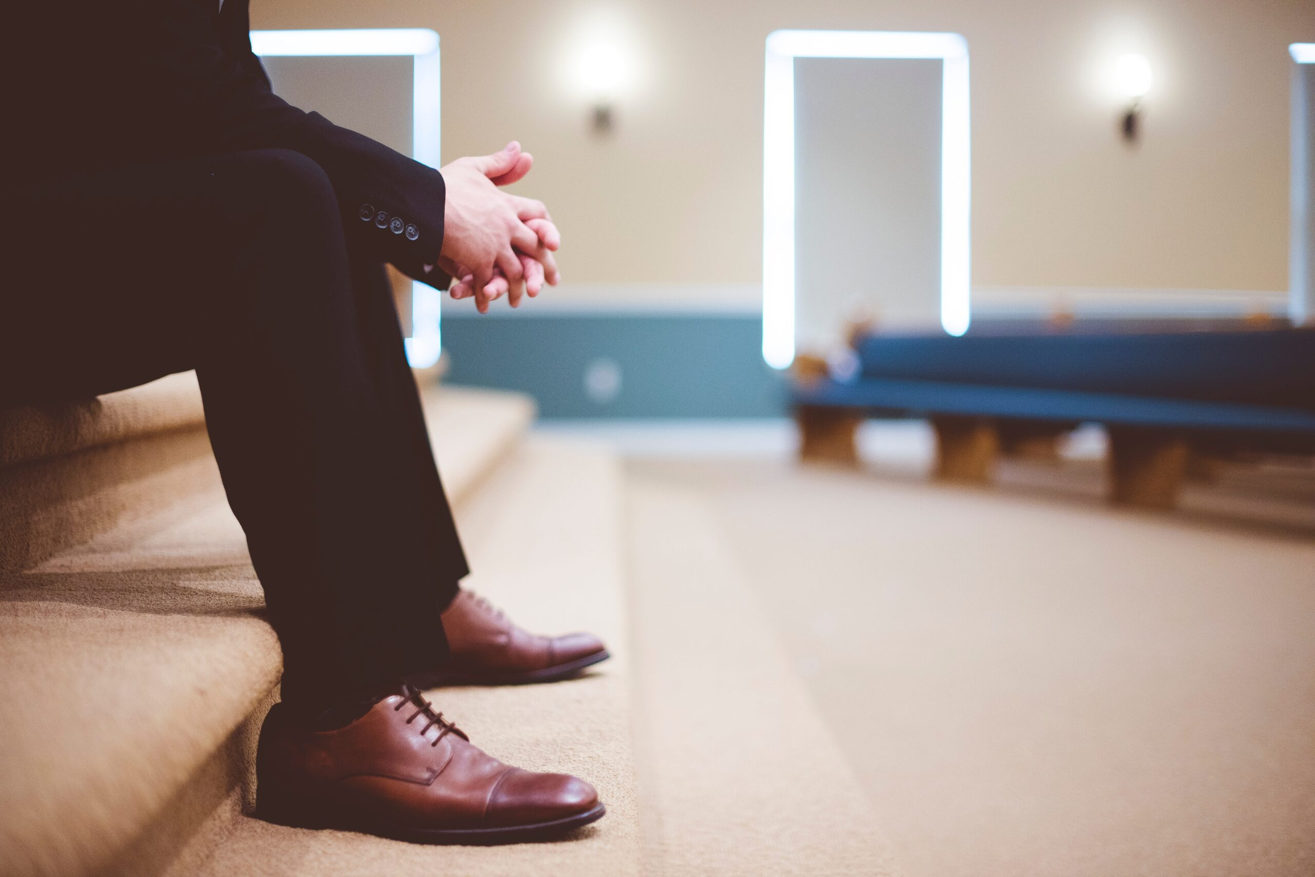 Man sitting in church with folded hands