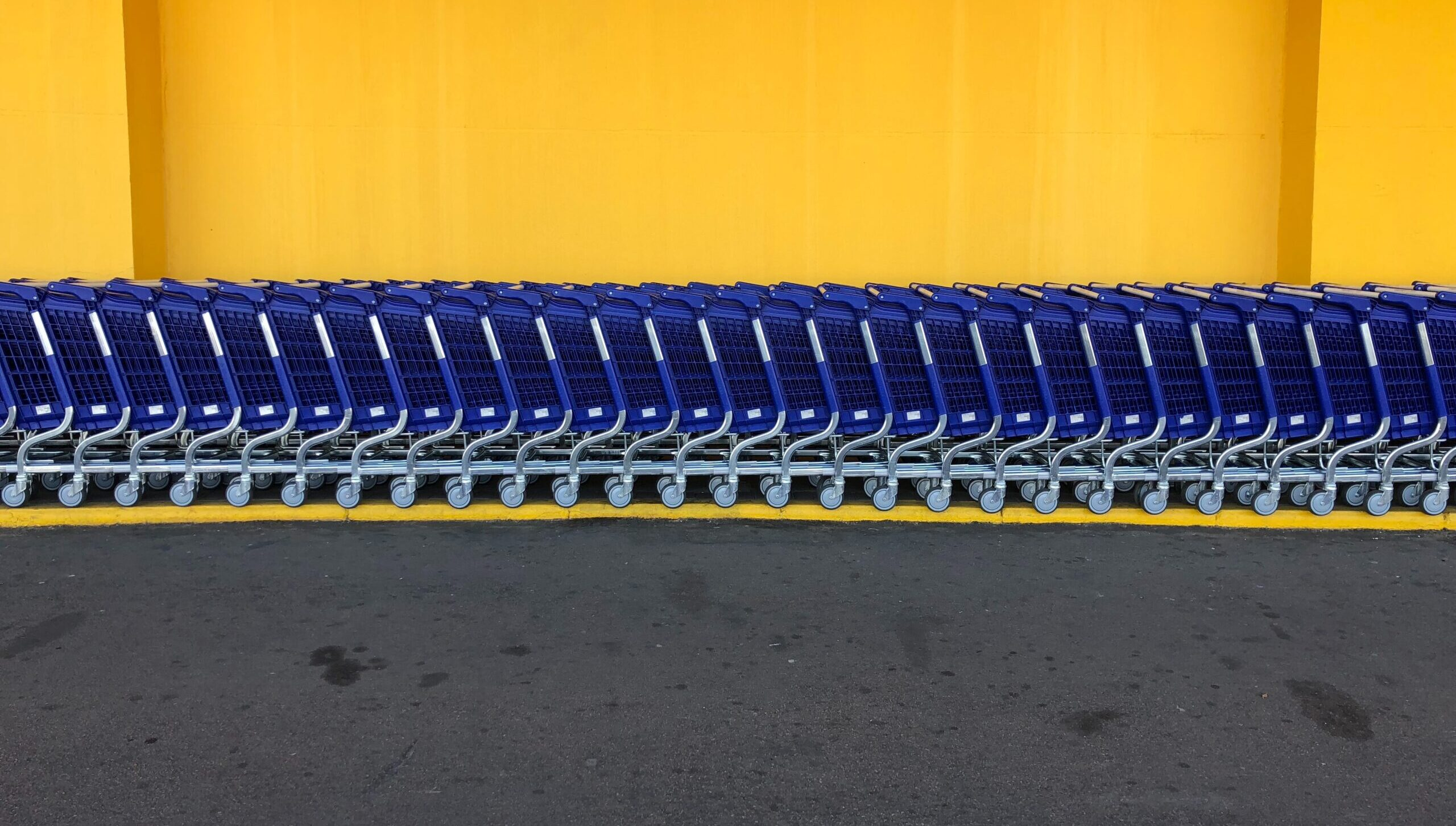 line of blue shopping carts