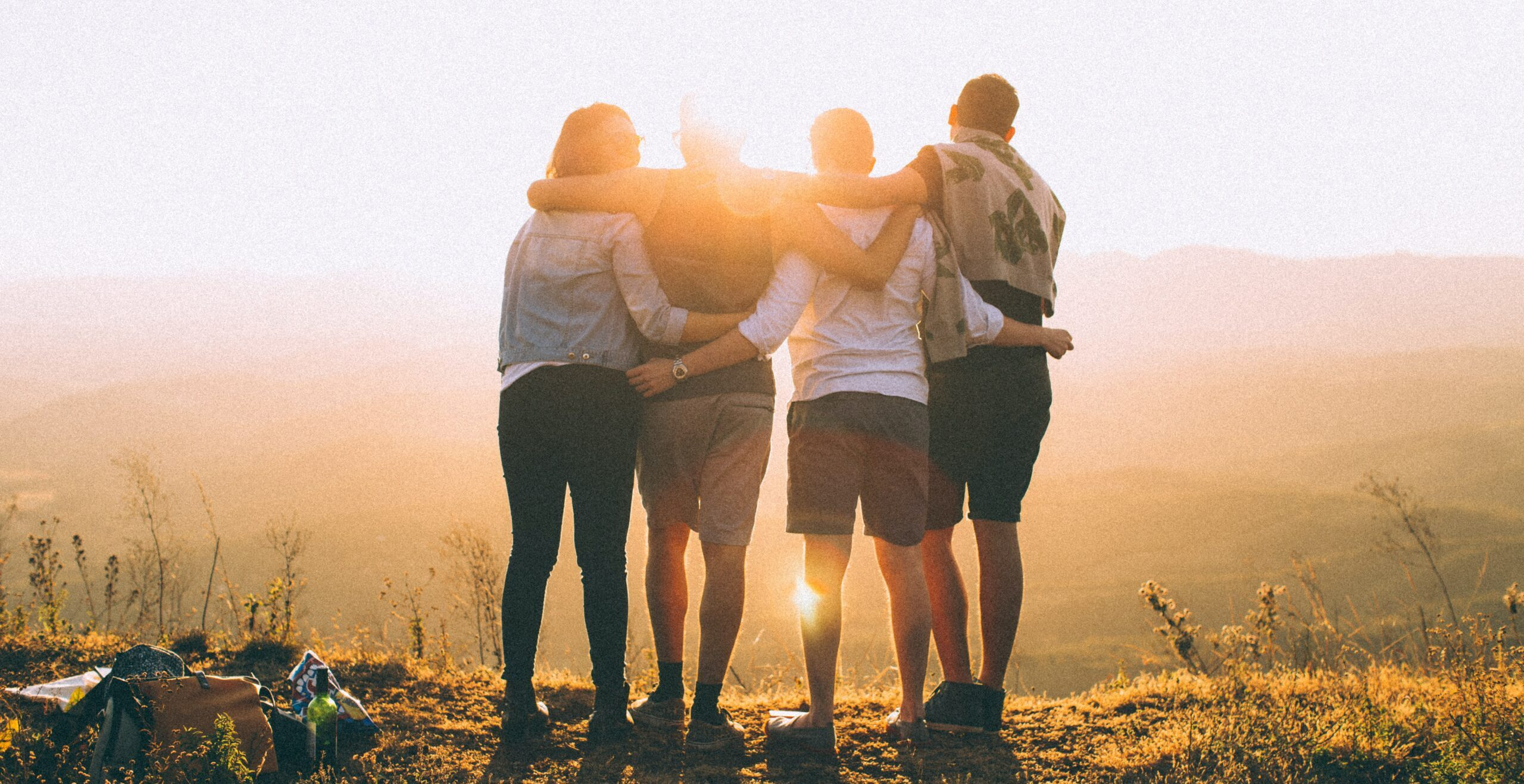 Group of four people watching the sunset